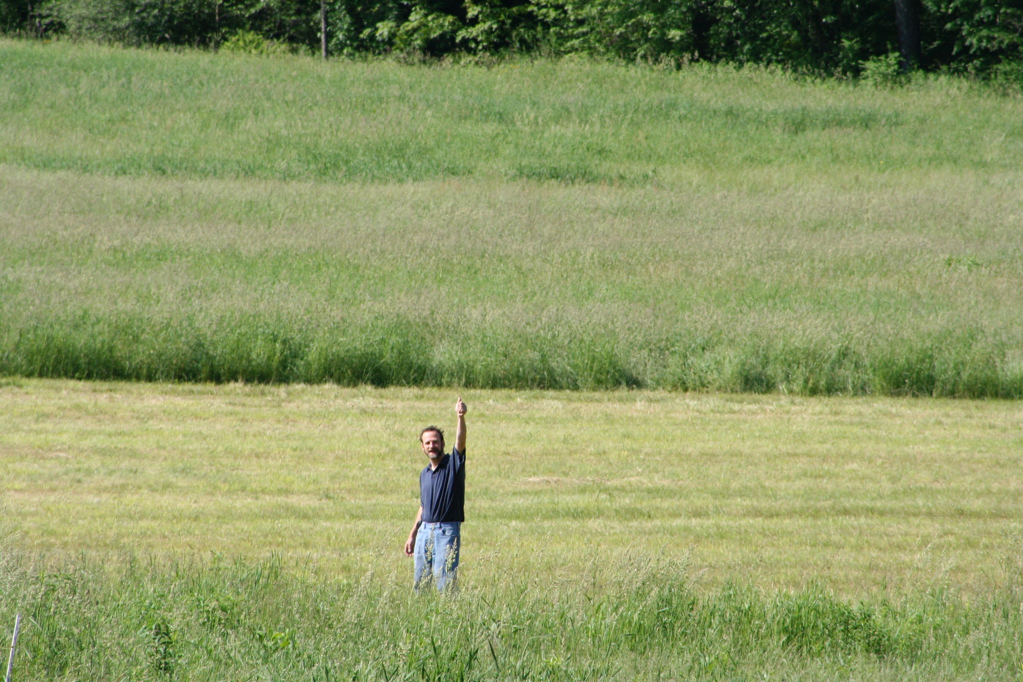 Michael waving from the large field